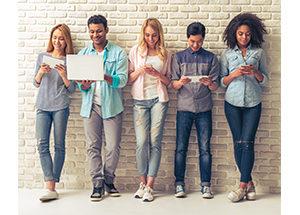 millennials looking at gadgets